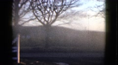 1958: a bright foggy meadow and smoky hillside as seen from over a fence NEVADA Stock Footage