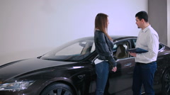 Manager talking with girl near the car Stock Footage