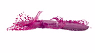 Purple drops falling on white surface slow motion. juice Stock Footage
