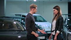 Girl ask boyfriend give her car's keys in salon Stock Footage