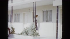 1958: a beautiful lady walking along the veranda and getting out NEVADA Stock Footage