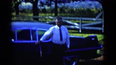 1958: a man in a tie exits a car closes the door and walks casually  Stock Footage
