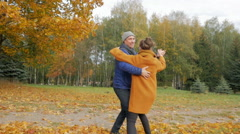 Father teaches daughter dancing in the autumn park. However, they smile and Stock Footage