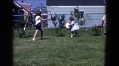 1955: brother and his two sisters playing in the backyard HICKSVILLE, NEW YORK Stock Footage