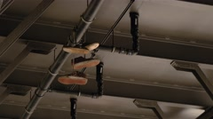 Locked down shot of tossing shoes under the bridge at Oberbaumstrasse in Berlin Stock Footage
