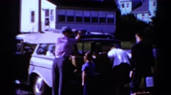 1964: packing the station wagon for a long family vacation CALIFORNIA Stock Footage