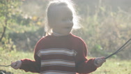 Girl child playing with branches Stock Footage