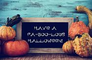 Pumpkins and chalkboard with text have a fa-boo-lous halloween Stock Photos