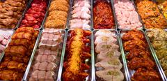 Variety of marinated meat at display counter Stock Photos