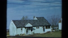 1964: zoom in and then zoom out on single-family home CALIFORNIA Stock Footage