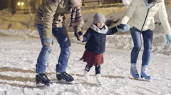Parents Teaching Daughter to Ice Skate Stock Footage
