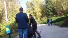 Walking along alley Territory of Central siberian botanical garden Stock Footage