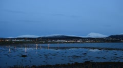 Tromsoe city island langnes side after sunset with heavy car traffic Stock Footage