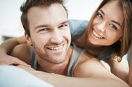 Smiling young couple looking at camera Stock Photos