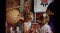 1964: a kindergarten class is participating in an activity with their teacher Stock Footage