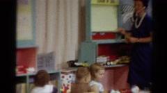 1964: kindergarten teacher teaching kids small nursery CALIFORNIA Stock Footage