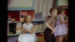 1964: three beautiful kids playing in the room by making circular motion Stock Footage