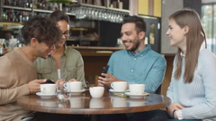 Group of Young Mixed race People using Phones in Coffee Shop. Stock Footage
