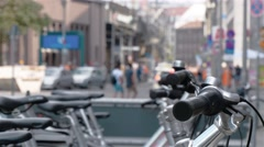 Traffic on Friedrichstrasse with focus on the city bike parking in Berlin Stock Footage