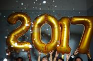 Number of next year held by happy clubbers 2017 Stock Photos