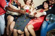 Toasting friends having joyful party Stock Photos
