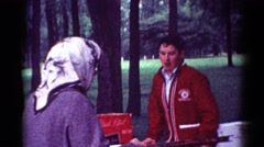1964: family members are gathered at a beautiful picnic area for a social event Stock Footage
