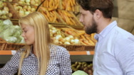 Couple shopping at the vegetable section of supermarket Stock Footage