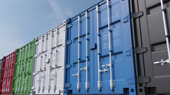 Row of multicolored cargo containers against blue sky. 4K seamless loopable Stock Footage