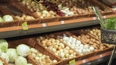Couple roll trolley with products at the hypermarket Stock Footage