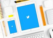 Twitter application on display of iPad and iPhone Stock Photos