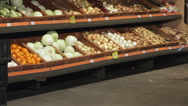 Couple walk with trolley near the display with vegetables Stock Footage