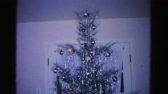 1967: christmas tree with tinsel and colored balls by window HAGERSTOWN Stock Footage