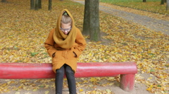 The daughter of his father's long time waiting on the bench autumn park. Dad Stock Footage