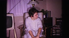 1967: a young girl in a white dress opens a cardboard box HAGERSTOWN, MARYLAND Stock Footage