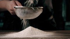 Chief's Hands Sifting Flour Through a Sieve For Baking Stock Footage