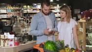 Couple choose tea at the hypermarket Stock Footage