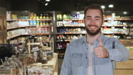 Man shows his thumb up at the mall Stock Footage