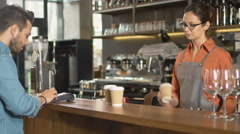 Handsome Young Man Paying for Takeaway Coffee with Credit Card at Coffee Shop. Stock Footage