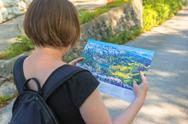 Woman looking at map of Bohinj lake area Stock Photos