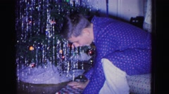 1967: a boy is busy with opening the present got for christmas day HAGERSTOWN Stock Footage