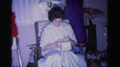 1967: woman receives new bracelet as a christmas gift and is excited to show it Stock Footage