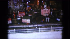 1951: a toy train on a track circling underneath a christmas tree CLEVELAND Stock Footage