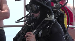 Woman scuba diver close-up check equipment before  immersion in water Stock Footage