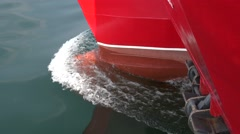 Nose catamaran ship with red board cuts the waves of the sea Stock Footage