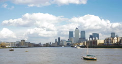 The River Thames and Docklands skyline, London, UK; pan Stock Footage