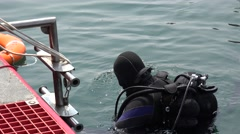 Diver after dive on water surface in sea Stock Footage