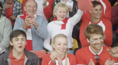4K Excited fans in sports crowd cheering on their team Stock Footage