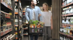 Couple shopping at the supermarket Stock Footage