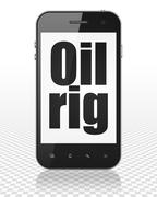 Manufacuring concept: Smartphone with Oil Rig on display Stock Illustration