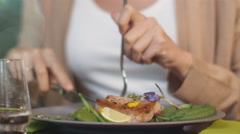 Attractive Young Woman Enjoying Fish Steak at Luxury Restaurant. Stock Footage